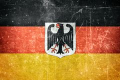 Flag of Germany with coat of arms. The flag of Germany with the German Coat of Arms on top Royalty Free Stock Image