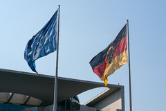 Flag of Germany and EU. Flag of Germany and the European Union against the sky Royalty Free Stock Image