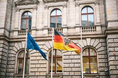 Flag of Germany and the European Union in Berlin. State symbol and national government flag of the Federal Republic of royalty free stock image