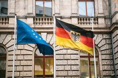 Flag of Germany and the European Union in Berlin. State symbol and national government flag of the Federal Republic of stock photo