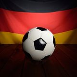 Flag of Germany with football on wooden boards. Royalty Free Stock Photography