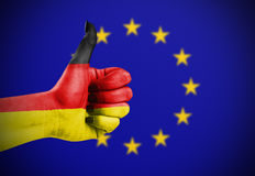 Flag of Germany. Painted on hand aganinst European Union flag Stock Images