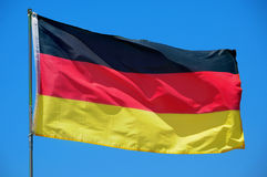Flag of Germany waving on the wind Stock Images