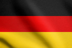 Flag of Germany waving in wind with fabric texture Royalty Free Stock Images