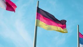 Flag of Germany waving in the wind in front of blue sky.  stock video footage