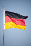 Flag of Germany in the wind. Black, red and yellow flag of the German republic Stock Images