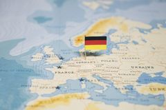 The Flag of germany in the world map.  royalty free stock photography