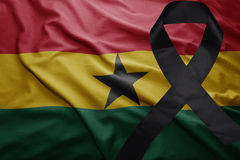 Flag of ghana with black mourning ribbon Stock Photos