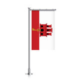 Flag of Gibraltar hanging on a pole. Stock Image