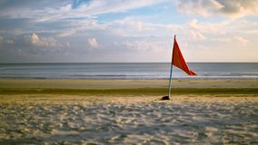Flag with Golden Sunset and Sand Stock Image