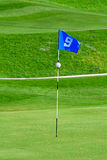 Flag on golf course. 9th flag on the golf course Stock Photography