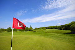 Flag on golf course Royalty Free Stock Image