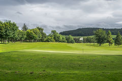 Flag on a golf course. A flag on a green of a golf course in Scotland Royalty Free Stock Photo