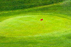 Flag on Golf Green. Red Flag on Golf Green Royalty Free Stock Image