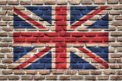 Flag of Great Britain. United Kingdom (Great Britain) national flag spray painted on a brick wall. Grunge graffiti Royalty Free Stock Image