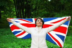 Flag of Great Britain. Young woman holding flag of Great Britain Royalty Free Stock Images
