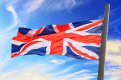 UK flag. Flag of Great Britain against the background of the sky Royalty Free Stock Image