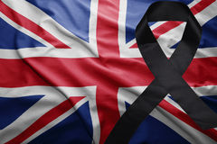 Flag of great britain with black mourning ribbon. Waving national flag of great britain with black mourning ribbon Royalty Free Stock Images