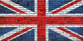 Flag of Great Britain on a brick wall. Grunge flag of Great Britain on a brick wall - Illustration Stock Photos