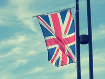 Flag of Great Britain. On a cloudy summer sky Stock Photography