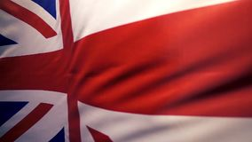 The flag of Great Britain flutters, slow motion stock video footage