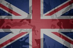 Flag of great britain on the khaki texture . military concept Stock Photo