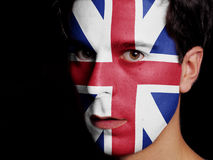 Flag of Great Britain. Painted on a Face of a Young Man Stock Image