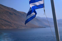 Flag of Greece. Cruise on South coast of island Crete, Greece Stock Photos