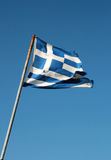 Flag of greece. An Greece flag that is falling apart after flying for so long Royalty Free Stock Photos