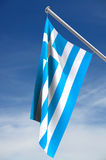 Flag Of Greece. With blue sky background; includes clipping path stock image