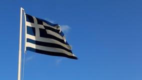 Flag of Greece against blue sky stock footage