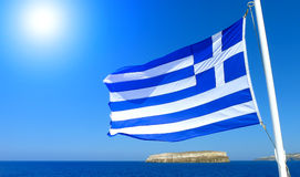 Flag of Greece with blue sky and sea and the sun royalty free stock image
