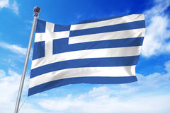 Flag of Greece developing against a clear blue sky Royalty Free Stock Image