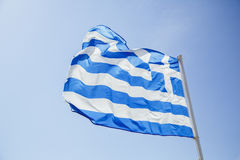 Flag of Greece develops against the sky Stock Image