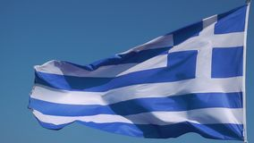 Flag of Greece. Waving greek flag agaist the blue sky. Seamless loop stock video