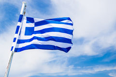 FLAG OF GREECE. Greek flag waving in the wind under the sky, representing the beauty of Greece Royalty Free Stock Image