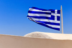 Flag of Greece. Photo of greece flag at roof of Oia house royalty free stock image