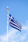 The flag of Greece over blue sky. Royalty Free Stock Images