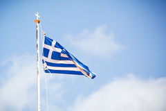 The flag of Greece over blue sky. Royalty Free Stock Image