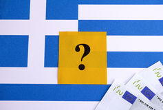 Flag of Greece with question mark and euro banknotes Royalty Free Stock Photography