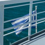 Flag of Greece on the rear of a boat stock photos