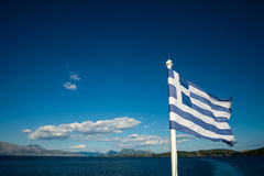 Flag of Greece with the sea Stock Photo