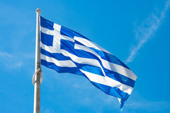 Flag of Greece. Waving in the wind against a blue sky Royalty Free Stock Image