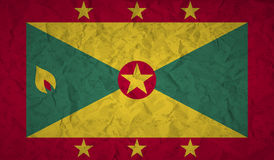 Flag of Grenada with the effect crumpled paper and grunge Stock Images