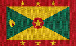 Flag of Grenada on old linen Stock Photos