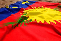 Flag of Guadeloupe on a wooden desk background. Silk flag top view.  royalty free stock photo