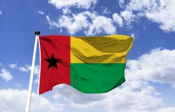 Flag of Guinea-Bissau, liberation of the African peoples. Flag of Guinea-Bissau represents the liberation of the African peoples. Green forests and agriculture royalty free stock photography