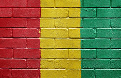 Flag of Guinea on brick wall Stock Photography