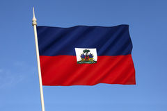 Flag of Haiti. The national flag of Haiti. The coat of arms depicts a trophy of weapons ready to defend freedom and a royal palm of independence. The palm is Royalty Free Stock Image