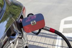 Flag of Haiti on the car`s fuel filler flap. stock images